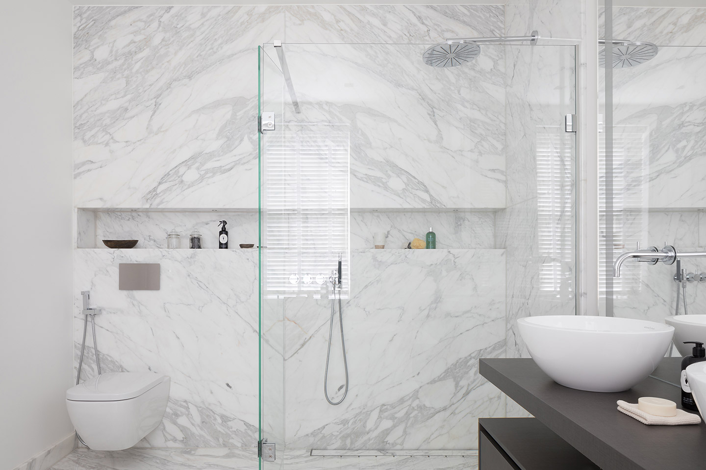 White marble carrara cladded bathroom suite
